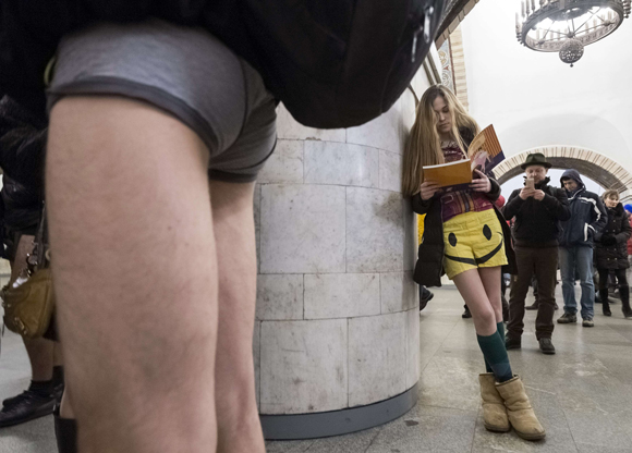 "Passengers without their pants wait on a underground platform during the ""No Pants Subway Ride"" in Kiev"